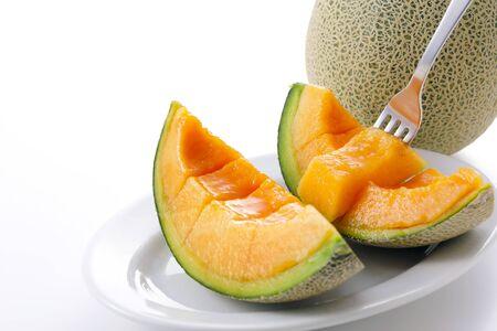 Cantaloupe melons on white Imagens