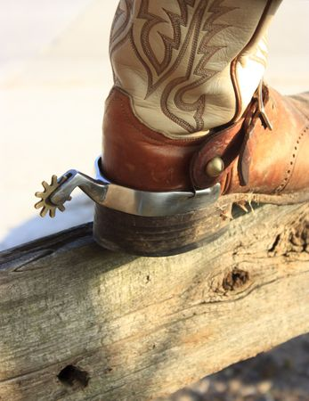 Two of the working tools of a Texas cowboy, boot and spur. Stock Photo - 5330466