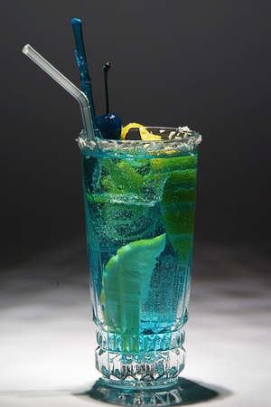Blue drink with citron and ice. Studio shot. photo