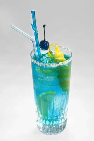 Blue drink with citron and blue cherry. Studio shot. photo