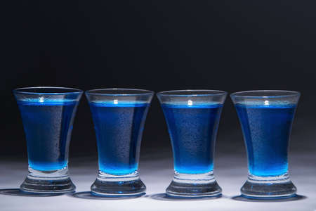 Four glasses with blue alcohol. Studio shot. Stock Photo - 869541