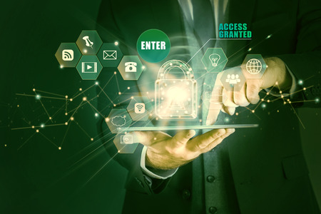 Businessman holding tablet with hologram of the concept of data protection, access granted. Man secures personal information on tablet