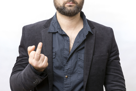 Man in black suit showing the middle finger fuck off sign on white background