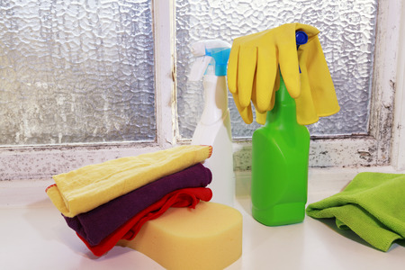 Various cleaning supplies, housekeeping, Dirty Window full of Mold Imagens - 124881121