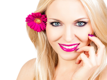 Beautiful woman with a flower in her hair photo