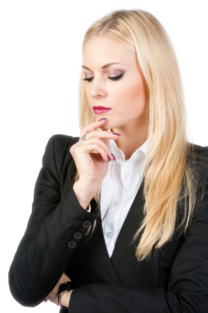 Pensive business woman on a white background photo