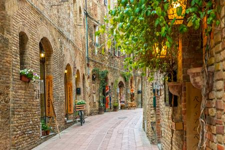 italy street: Alley in old town San Gimignano Tuscany Italy Stock Photo
