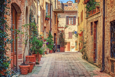 Alley in old town Tuscany Italy 写真素材