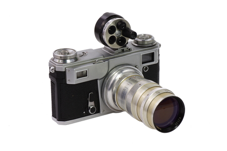 telephoto: Old camera, classic (SLR) 135 format with a telephoto lens  and universal  viewfinder on a white background