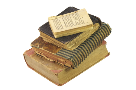 Old books, have almost a century, hand bound by a bookbinder and the old scout songbook. On the white background, isolated.