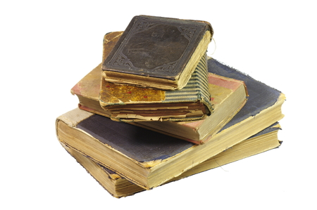 luminaire: Old books, have almost a century, hand bound by a bookbinder. On the white background, isolated. Stock Photo