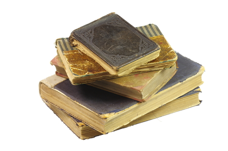 Old books, have almost a century, hand bound by a bookbinder. On the white background, isolated. Zdjęcie Seryjne