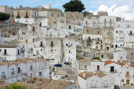 foggia: Monte Sant Angelo, Italy - September 11, 2015: view of a portion of the old part of the city built on a hillside. Typical architecture of the Mediterranean. Editorial