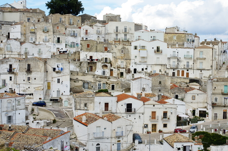 monte sant angelo: Monte Sant Angelo, Italy - September 11, 2015: view of a portion of the old part of the city built on a hillside. Typical architecture of the Mediterranean. Editorial