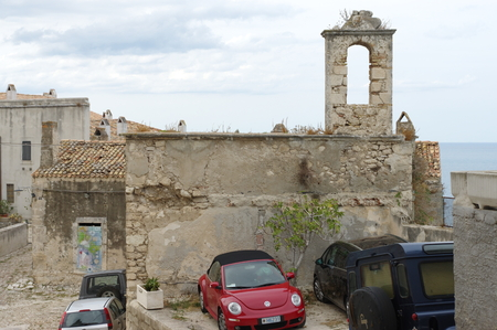 foggia: Peschici, Italy - September 09, 2015: center of the historic town on the Gargano Peninsula in the province of Foggia. In the image are the visible ruins of the St. Michele church.