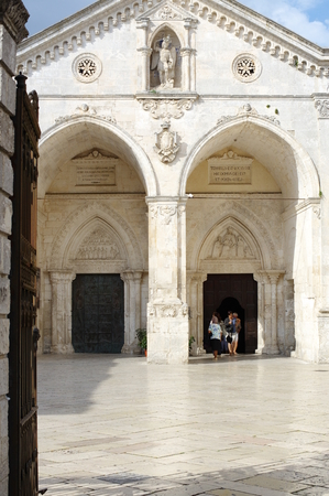 foggia: Monte Sant Angelo, Italy - September 11, 2015: The historic town on the Gargano Peninsula in the province of Foggia. Entry to the Shrine of Saint Michael the Archangel. Editorial