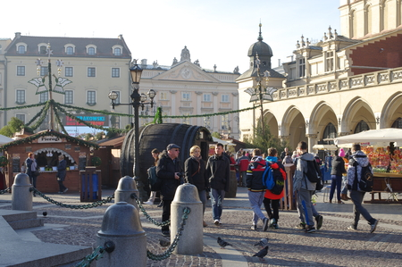 main market: Krakow, Poland December 04, 2015: Christmas fair on the Main Market Square. Stals with food, drinks and Christmas ornamentation. Editorial