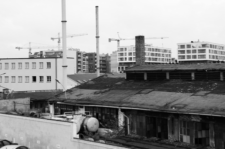 industrial district: Krakow, Poland - August 11, 2016: Podgorze, old industrial district of Krakow. In the background there are new buildings and cranes working on the construction site. Editorial