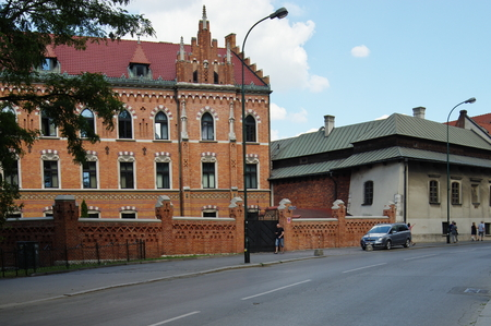 Krakow, Poland - August 25, 2016: Podzamcze street. On the right side is the House of Dlugosz. Built in the fourteenth century, it housed the royal bath. Currently it is the seat of the University Rector of the Pontifical John Paul II in Krakow. Editorial