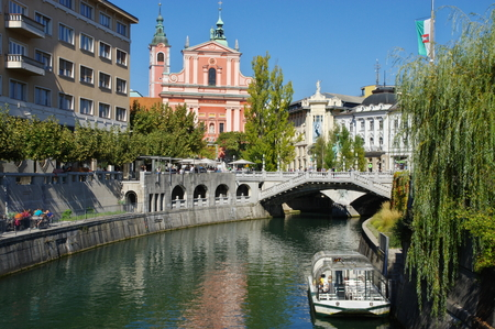 Ljubljana, Slovenia, September 25, 2016, City center, Ljubljanica River. Triple Bridge. On the river is a tourist ship. Editorial