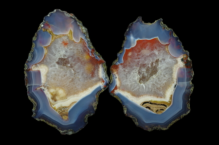 A cross section of the agate stone with quartz geode. Multicolored silica rings colored with metal oxides are visible. Origin: Asni, Atlas Mountains, Morocco.