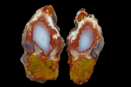 A cross section of the agate stone. Multicolored silica rings colored with metal oxides are visible. Origin: Asni, Atlas Mountains, Morocco. Stock Photo