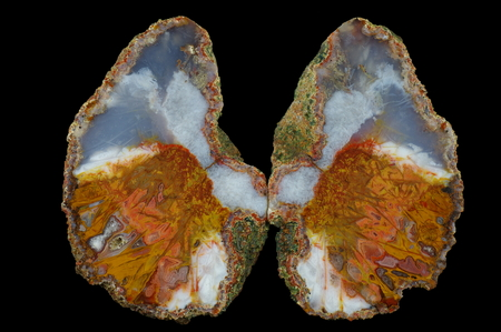 A cross section of the agate stone. Multicolored silica bands colored with metal oxides are visible. Origin: Asni, Atlas Mountains, Morocco. Stock Photo