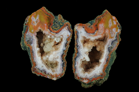 A cross section of the agate stone. Multicolored silica rings with colored metal oxides are visible. Inside geode is a calcite brush with goethite. Origin: Asni, Atlas Mountains, Morocco.