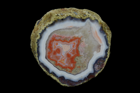 A cross section of the eyelet agate stone. Multicolored silica rings colored with metal oxides are visible. Origin: Asni, Atlas Mountains, Morocco.