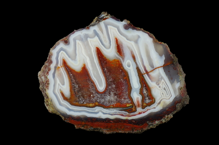 A cross section of the stalactite agate stone with quartz geode. Multicolored silica rings colored with metal oxides are visible. Origin: Asni, Atlas Mountains, Morocco.