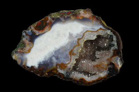 A cross section of the agate stone with quartz geode. Multicolored silica rings with colored metal oxides are visible. Origin: Asni, Atlas Mountains, Morocco.