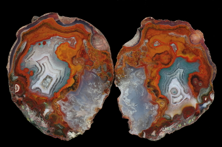A cross section of the agate stone. At the bottom is a gray-blue pseudomorphosis. Multicolored silica rings colored with metal oxides are visible. Origin: Asni, Atlas Mountains, Morocco.