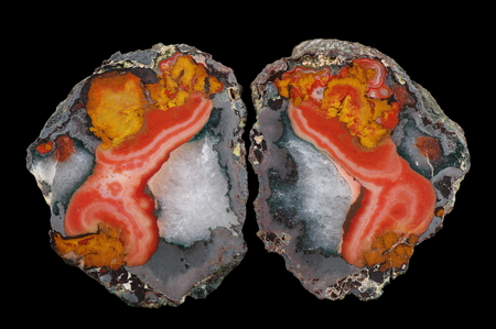 A cross section of the agate stone with hematite (gray) and quartz (white). Multicolored silica bands colored with metal oxides are visible. Origin: Asni, Atlas Mountains, Morocco.