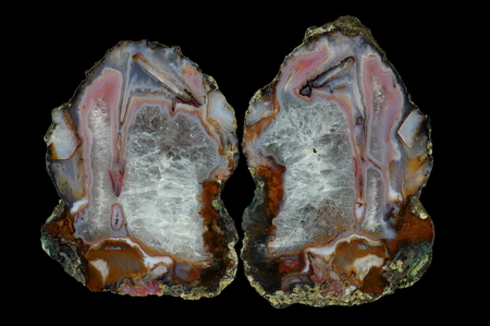 Agate with pseudomorphosis and crystalline quartz. Multicolored silica bands colored with metal oxides are visible. Origin: Asni, Atlas Mountains, Morocco.