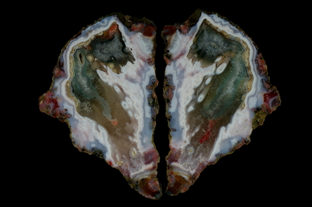 Eyelet agate filled with colored quartz structures. Multicolored silica bands colored with metal oxides are visible. Origin: Asni, Atlas Mountains, Morocco.