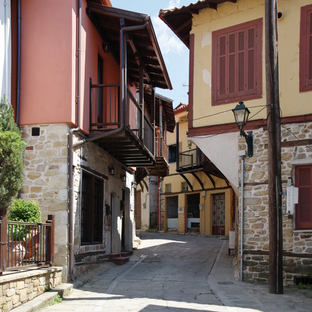 Arnea, a small town near the Chalkidiki peninsula in northen Greece. Region of Macedonia. Street in the city center. Along the road are houses with typical architecture of the region.
