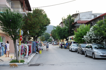 Asprovalta, summer resort in northern Greece on the Aegean Sea. Street in the evening. Visited numerous shops, taverns and strolling tourists. Editorial