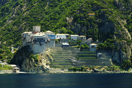 Athos peninsula, Greece. The Monastery of Dionysiou located in the Monks Republic on the peninsula of Athos. View from a cruise ship.