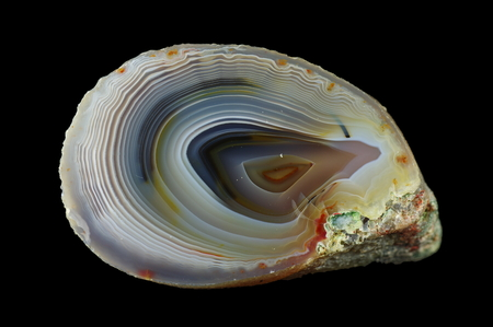 Concentric agate. Multicolored silica bands colored with metal oxides are visible. Origin: Rudno near Krakow, Poland.