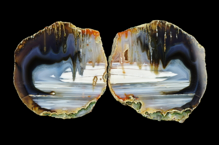 A cross section of agate stone. Stalactite agate. Multicolored silica bands colored with metal oxides are visible. Origin: Rudno near Krakow, Poland.