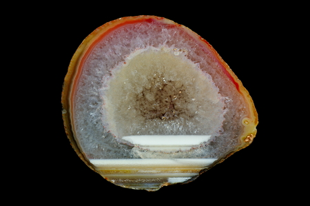 A cross section of agate stone. Horizontal agate filled with quartz. Origin: Rudno near Krakow, Poland. Stock Photo
