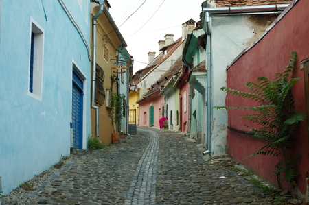 Sighisoara, Transylvania, Romania – September 11, 2017: the road leading to the medieval old town. Buildings typical for the region. 에디토리얼