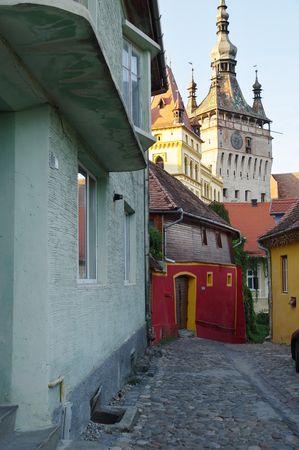 Sighisoara, Transylvania, Romania – September 11, 2017: the road leading to the medieval old town. Buildings typical for the region.