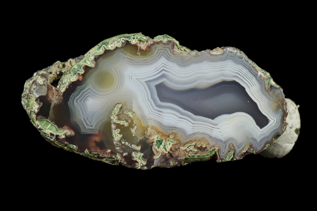 A cross-section of agate. Multicolored silica rings colored with metal oxides are visible. Concentric agate. Origin: Rudno near Krakow, Poland.