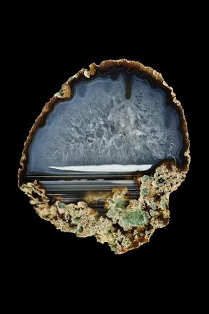 A cross-section of agate. Horizontal agate, filled with quartz. Origin: Rudno near Krakow, Poland.