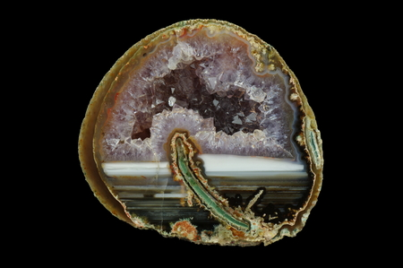 A cross-section of agate. Horizontal agate, filled with quartz with geode. Origin: Rudno near Krakow, Poland.