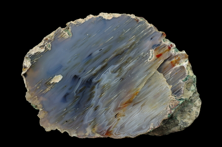 A cross-section of agate. Micro-stalactite agate (in reverse position). Multicolored silica bands colored with metal oxides are visible. Origin: Rudno near Krakow, Poland.