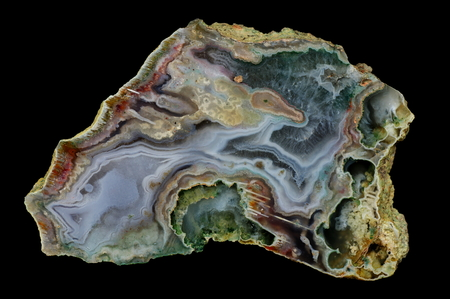 A cross-section of agate. Multicolored silica bands colored with metal oxides are visible. Origin: Rudno near Krakow, Poland.