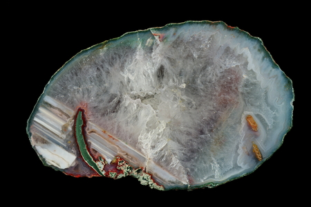 A cross-section of agate. Horizontal agate with quartz-agate fill (in reverse position). Origin: Rudno near Krakow, Poland.