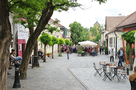 Szentendre, Hungary – May 17, 2018: small town near Budapest, capitol of Hungary. Dumtsa Jeno street. You can see shops, pubs and restaurants. Some tourists are walking on the street.